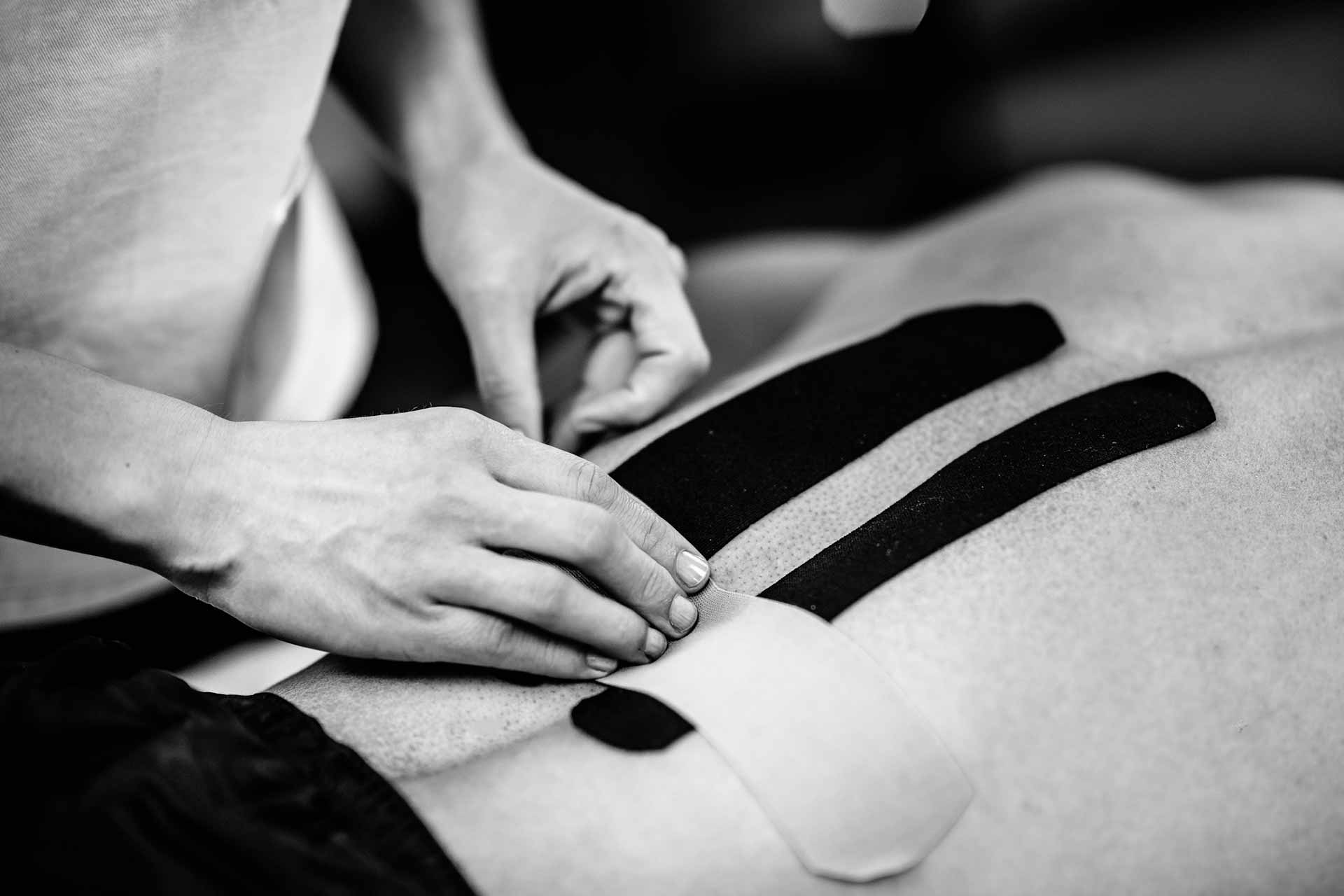 An image of a sportsman receiving expert kinesiology taping treatment - Moreno Osteopathy, you're in good hands